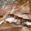 Quartz-limonite vein suggesting at least two episodes of dilation, the first associated with deposition of quartz, the second with the deposition of limonite. In this case, the vein is antitaxial because reopening occurred along the vein wall as opposed to the vein axis.